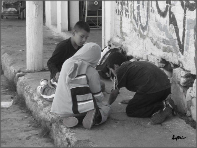 Boys playing a game on the sidewalk in San Antonio, Mexico customary for Ajijic people.