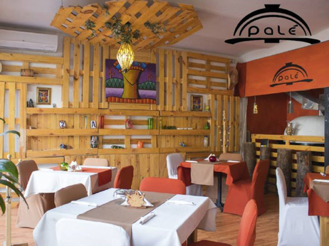 One of the newer Ajijic Restaurants indoor dining area with clothed tables and fabric covered chairs.