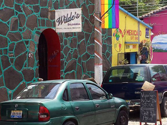 Street view of wilde's dildoria store with sign on will in ajijic, mexico