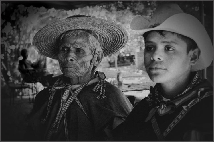 Black and white image by Photographer Jill Flyer Photo of a Huichol father and son.