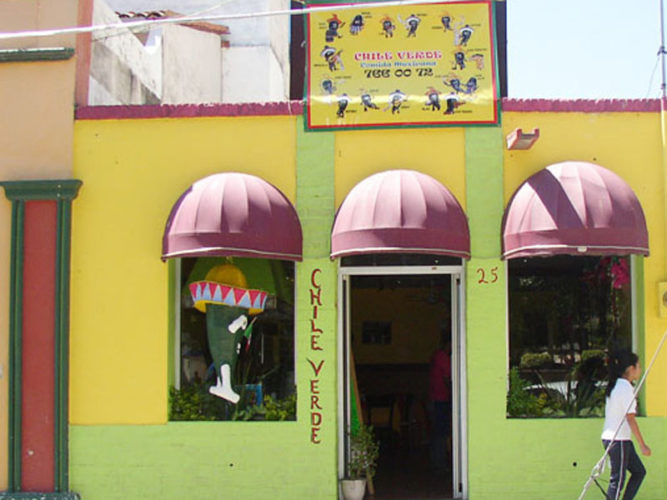 Downtown Ajijic Restaurant Chili Verder view from the street with purple awnings and yellow and green painted walls.