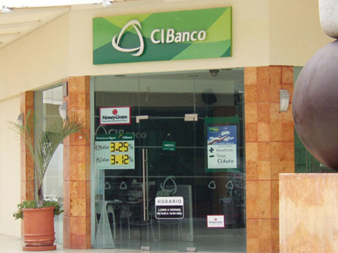 storefront of cibanco at centro laguna mall with green and white corporate signage plant out front and signs on windows