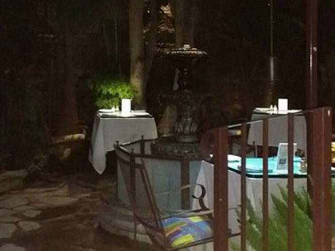 One of the many candle lite garden dining area of the Ajijic Restaurant, Go Bistro.