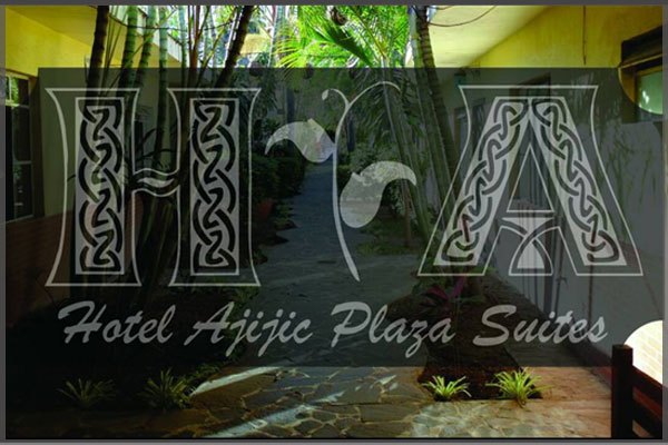 Logo and side garden area of Hotel Ajijic Plaza Suites.