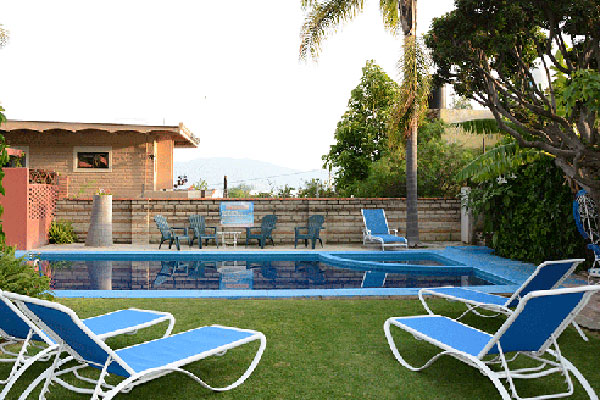 Pool with lounge chairs at Casa de la Abuela.