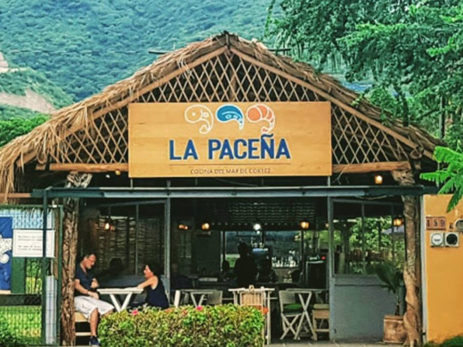 Street view of La Pacena restaurant with palapa roof is one of the newer Ajijic Restaurants.