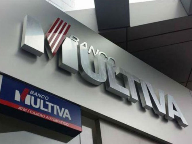 banco multiva blue red white and silver corporate lettering and sign above bank entrance
