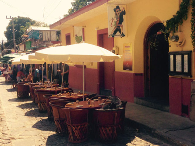 On of the more established Ajijic Restaurants is Ajijic Tango, showing their street dining with umbrellas.