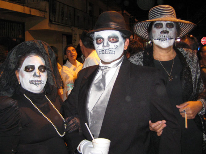 Three people dressed as Catrinas for Day of the Dead parade in Ajijic.