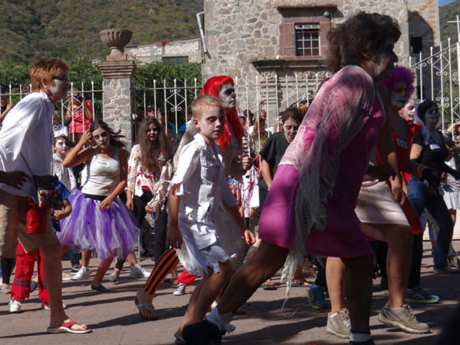 People dressed as zombies dancing to Michael Jacksons Thriller for day of the Dead festivities in Ajijic, Mexico.